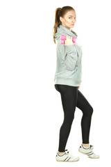 Girl in a tracksuit with dumbbells in hands isolated
