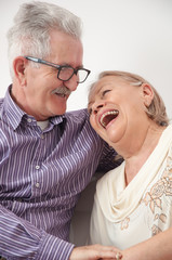Happy smiling senior couple enjoys hugs