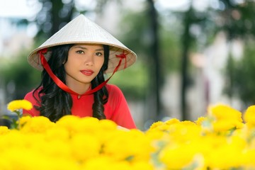 Young Vietnamese woman in a traditional hat