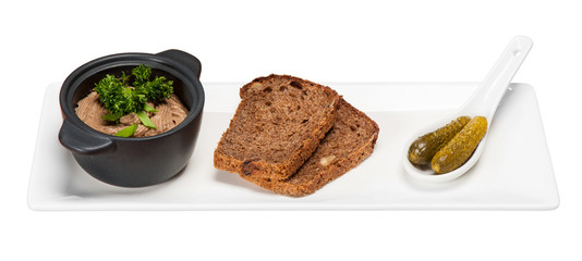 bowl of chicken liver pate bread and cucumbers