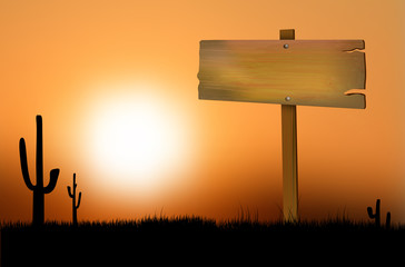 Wooden sign at sunset on the prairie