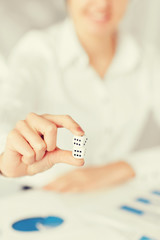man hands with gambling dices signing contract