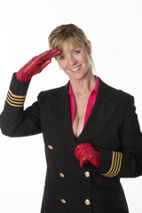 Saluting airline crew member wearing low cut uniform