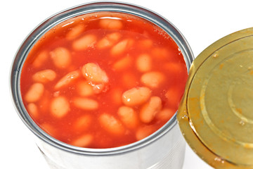 Open tin can of beans on white