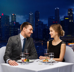smiling couple talking at restaurant