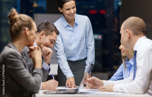 Leinwanddruck Bild smiling female boss talking to business team