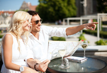 couple with map in cafe