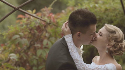 Newlyweds enjoy each other in park