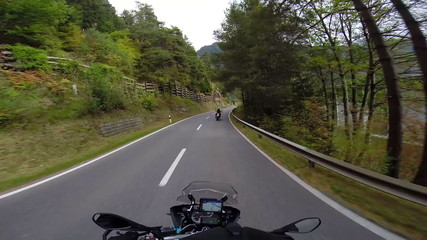 Motorbike Ride through forest with picture-esque view