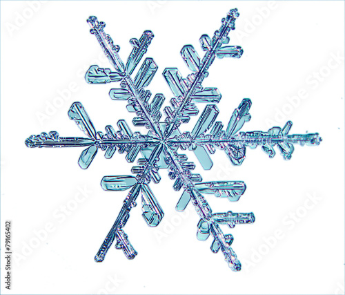 Leinwanddruck Bild snowflake crystal blue background