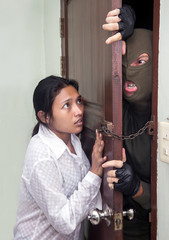 woman holds the door against the aggressor