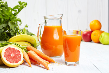 carrot juice on white wood table