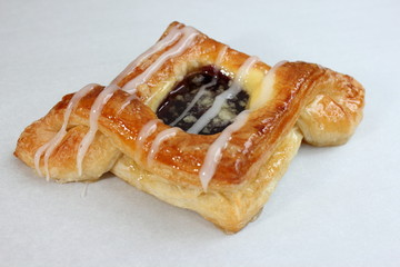 Blueberry pastry on a white background.