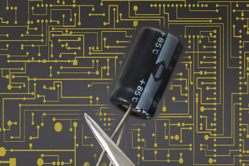Electronic capacitor in black background