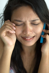 Woman crying with phone
