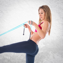 Sport woman stretching with rope