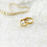 Two golden wedding rings with seamless flower decorations - 79169427