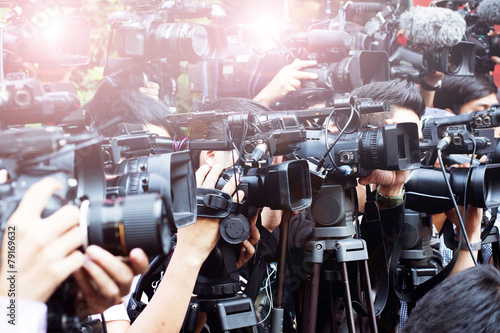 canvas print picture press and media camera ,video photographer on duty in public new