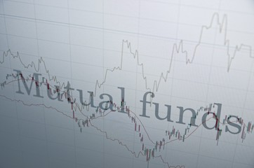 """Inscription """"Mutual funds"""" on PC screen. Financial concept."""