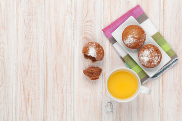 Homemade cakes and orange juice
