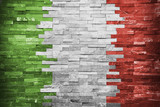 Fototapety Italian Flag in the wall building
