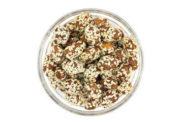 sweet peanuts in a glass on a white background