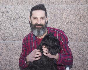 bearded man sitting with dog