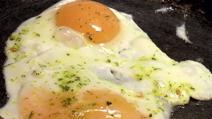The video shows cooking eggs