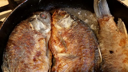 The video shows fried river fish