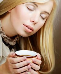 pretty woman drinking coffee