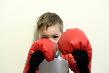 Child in boxing gloves