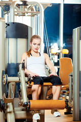 Gym leg extension exercise workout woman indoor