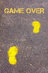 Yellow footsteps on sidewalk towards Game Over message
