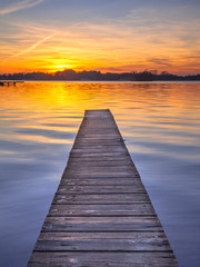 Majestic Sunset over Wooden Jetty in Groningen, Netherlands