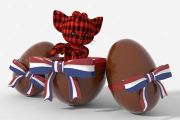 Uovo di Pasqua cioccolato con colori Paesi Bassi e peluche