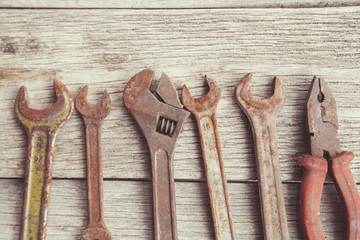 old, rusty tools on wooden background
