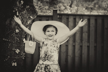 Girl Wearing a Big Sun Hat with Hands Up - Vintage