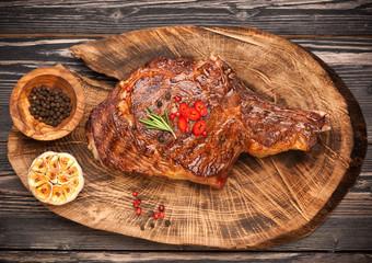 Grilled steak on wooden board