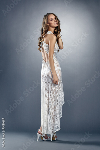 Attractive young model wearing sexy long negligee - 79180687