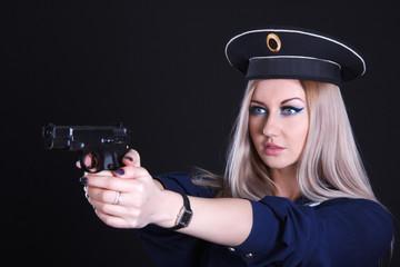 Woman in a navy uniform with a gun