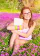 Beautiful student girl on flower field