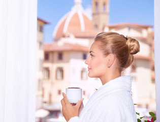 Drinking coffee on the balcony