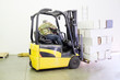 Forklift truck in warehouse or storage loading cardboard boxes