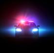 Police car pursued in the dark.