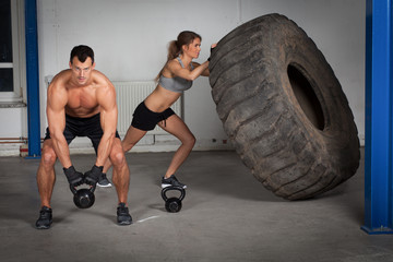 crossfit training - woman flipping tire