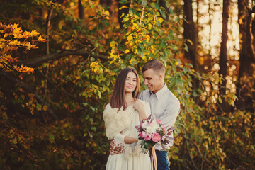 happy couple in the autumn forest