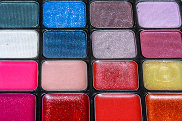 Close up of eye make up and blusher in various colors.
