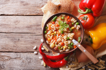 minestrone soup and ingredients. horizontal top view