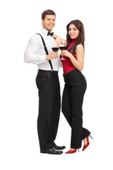 Young couple drinking red wine and posing
