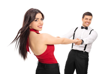 Young couple dancing and having fun